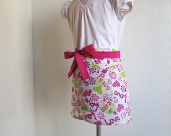 Childrens Half Apron - SALE Valentines..  Love, Peace and Pink and Green Hearts...a sweet kids apron...has a slight glittery sparkle to it