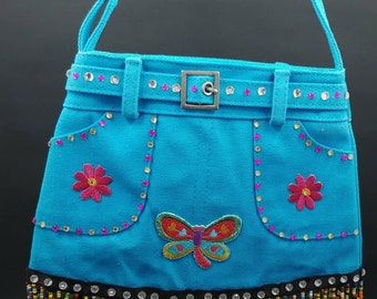 Handmade 1 of a kind small purse for all ages. Perfect size for your cellphone, wallet, make-up, ID, necessities. Pockets. Adjustable strap.