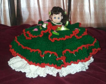 GORGEOUS HANDMADE CROCHET doll in a 3 layered 2 tone dress with a satin tie, a bow in her hair, beaded necklace secured on a handmade pillow