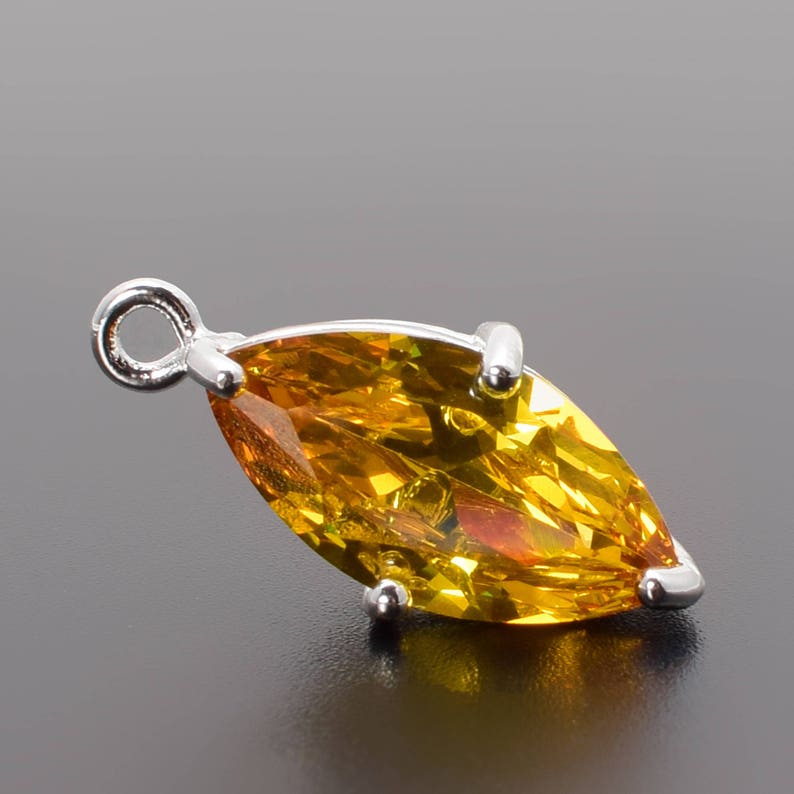 18mm Silver Plated over Brass Prong Setting. 2 Marquise Golden Zircon Pendant M1150354