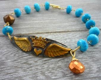 Winged crown & turquoise bead boho style bracelet.