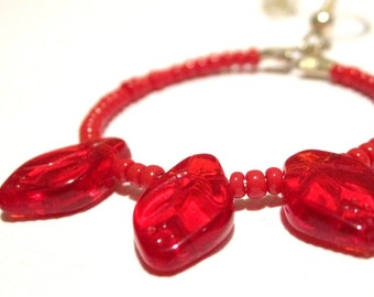 red beaded hoop earrings with glass leaves  boho bohemian hippie