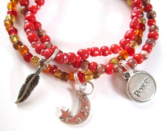 beaded charm bracelets set of 7 in brown, red, gold, yellow, and amber stretch elastic
