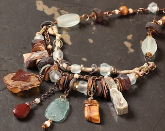 Archeology 2.0 necklace: Rough amber nugget, Roman glass, impression jasper, mixed metal, hammered bronze washers, sari silk, recycled glass