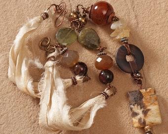 Autumn Earth semi precious stone necklace: recycled sari silk ribbon, leather, Jasper pendant, agate, citrine, green garnet