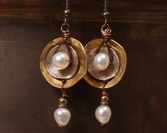 Radius Gold mixed metal earrings: geometric hammered brass and silver discs with wire wrapped pearls