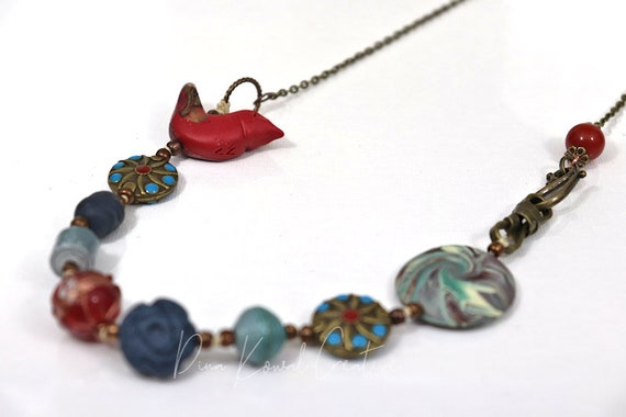 Bird Necklace - mix of metal and glass with handmade paper and polymer clay beads