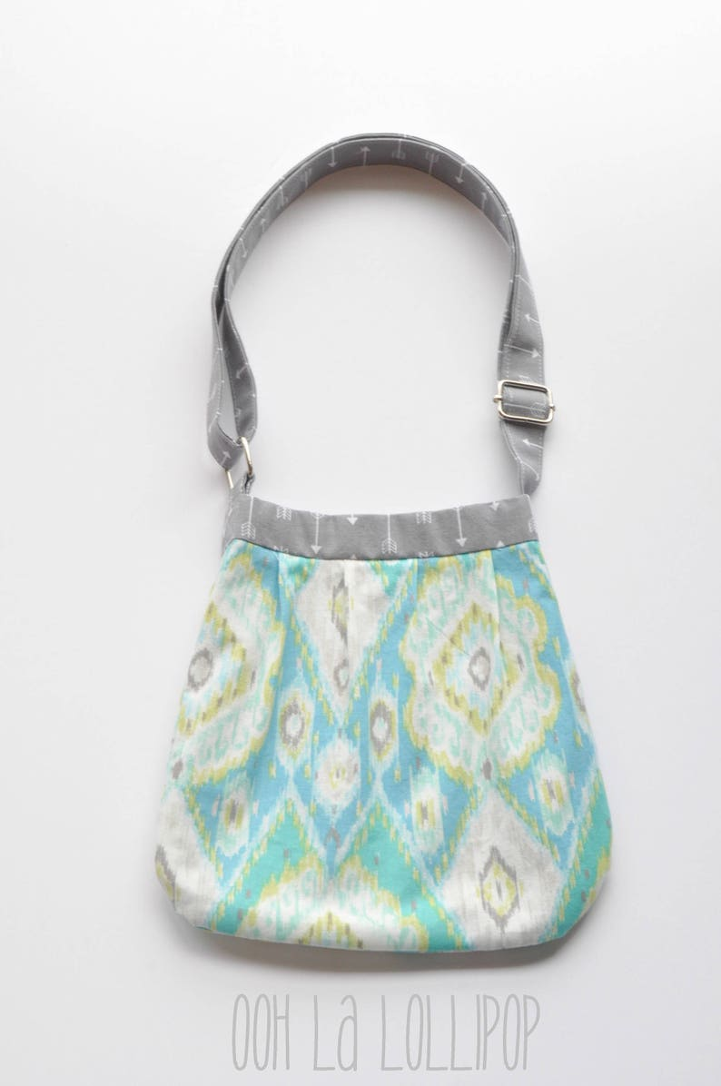 Adjustable Girl on the Go bag in beautiful aqua ikat print Girls Purse lined in gray arrow fabric