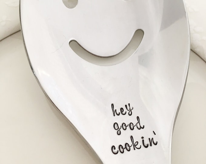 Hey good cookin'- Smiley face serving spoon. Stainless steel. Hand stamped.