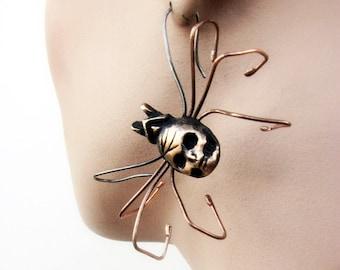 Skull spider earring bronze and titanium wire sculpture