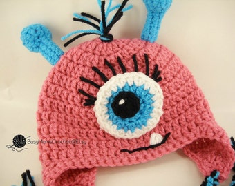 ebc26430147676 Handmade Crochet Baby girl monster hat with antennae and eyelashes, sizes 0  months to toddler size
