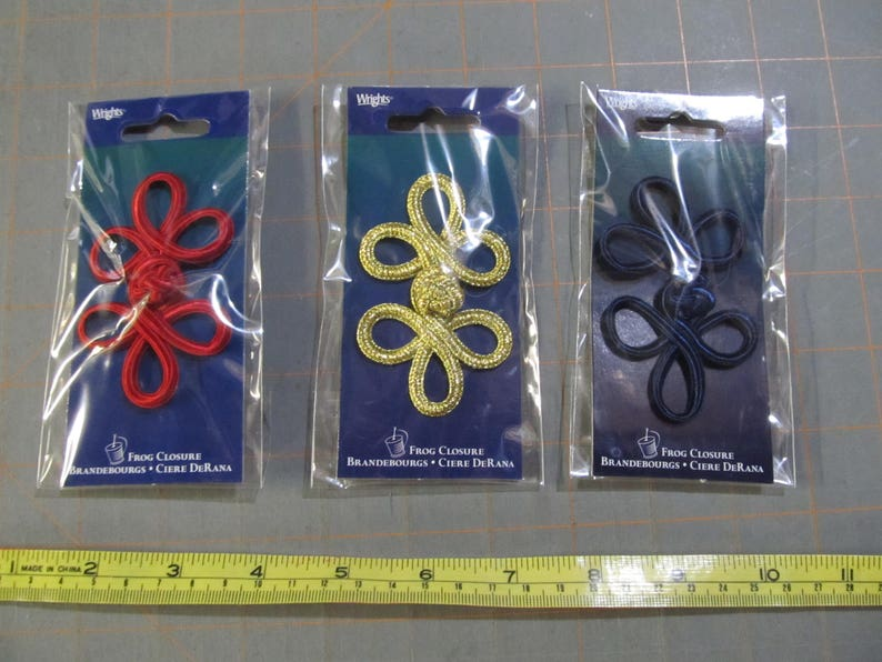 3 x 2 new in package gold and navy Frog closures red 3 dollar flat shipping rate sewing and crafts