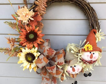 Grapevine scarecrow wreath with leaf bow