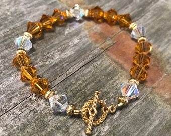 Brown and Clear Swarovski bracelet with gold toggle