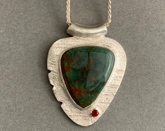 Turquoise and garnet silver pendant