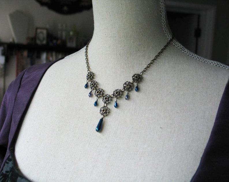 Flower Necklace with Blue and Gray Teardrop image 0