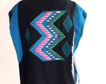 Vintage reversible Guatemalan vest with large hand embroidered geometric zig zag on back.