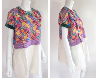 Vintage huipil tunic dress from Quetzaltenango, Guatemala with hand embroidered bodice