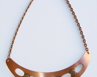 Vintage Modernist copper panel necklace 1960s. Bib pendant with cutouts. Statement necklace. Unworn vintage jewelry.