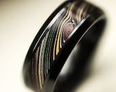 Black Ceramic Ring with Fordite