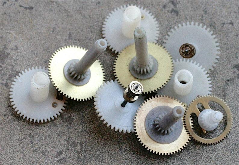 Vintage clock brass plastic gears -- set of 9 -- D3