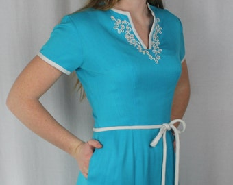 Turquoise wiggle dress by Bea Young linen asian design 1960s short sleeve pretty pleats white trim and belt pocket back zipper dressy size S