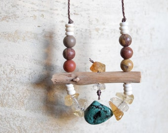 long primitive stone, bead, and crystal necklace