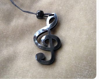 Acrylic Treble Clef Note Ornament with black string and black bead