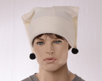 Harlequin Jester Cap in Ivory Fleece With Black Pompom with Two Tails Back facing Points
