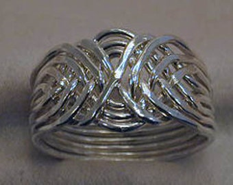 8 pc. Alternating Puzzle Ring Solid Sterling Silver.
