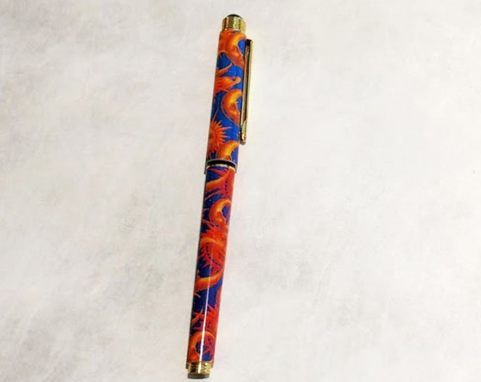 New! Celestial Rollerball refillable pen. Brilliant blue with vibrant sun and moon decoration.  Great gift for women, men, teens