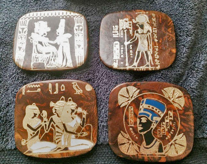 New! Egyptian Handtooled Leather Coasters. Set of 4 with handtooled leather holder. Marbled brown color. 4 beautiful designs. Great gift!