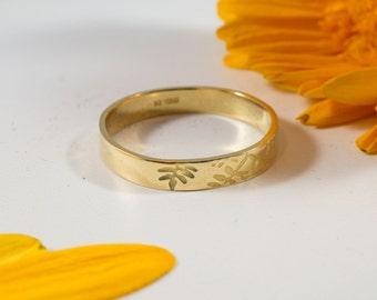 Gold Botanical Wedding Band: A 14k yellow recycled gold textured wedding ring band