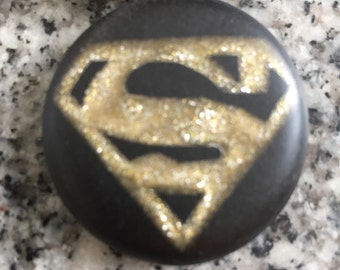 Super Hero hand carved on a polymer clay black color background. Pendant comes with a FREE necklace