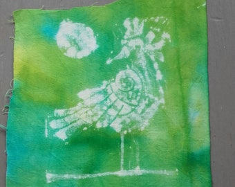 Printed crow and moon on tie dyed fabric