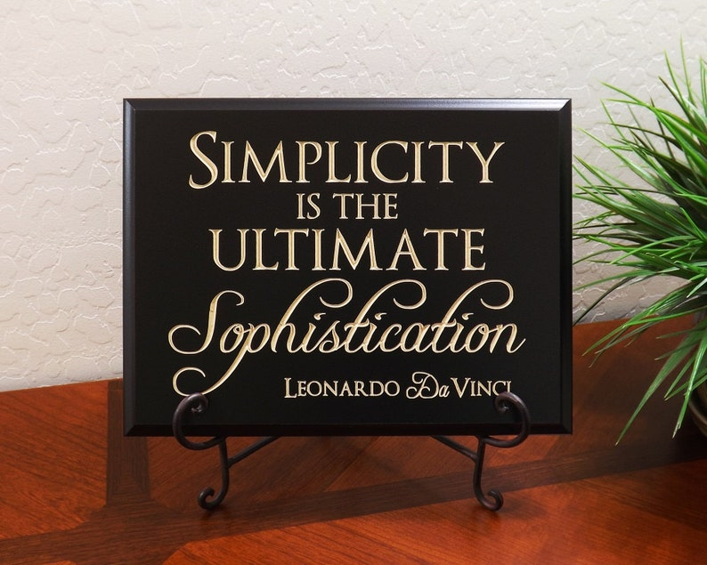 Decorative Carved Wood Sign with Quote Simplicity is the image 0
