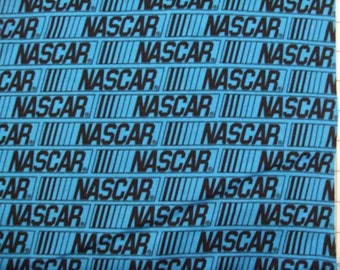 Blue with Nascar Motor Sports racing print 100% quality cotton fabric by the HALF yard.