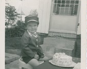 Birthday Boy Wearing a Pilot s Hat with Wings, a Suit with Short Pants and Bow Tie in Front of His Birthday Cake, Vintage Photo