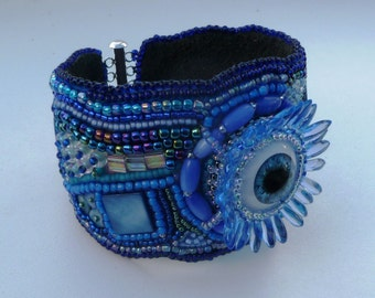Blue 'eye' and scarab  beaded cuff.