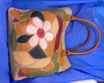 Leather appliqué tote.