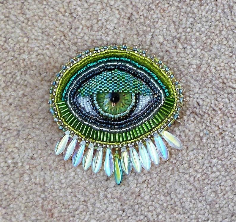 Green and silver /'EYE/' hand beaded broochpin