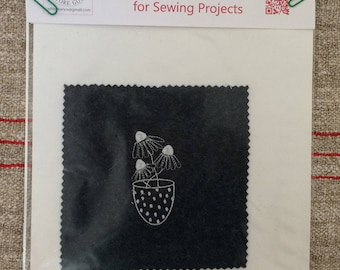 Embroidered piece for a home sewing project, wool felt, cross stitch heart and cat or coneflower in dotty vase.