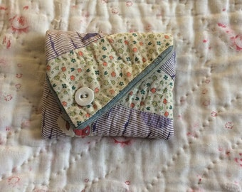 Vintage quilt 'purse' or pocket, worn and patched.