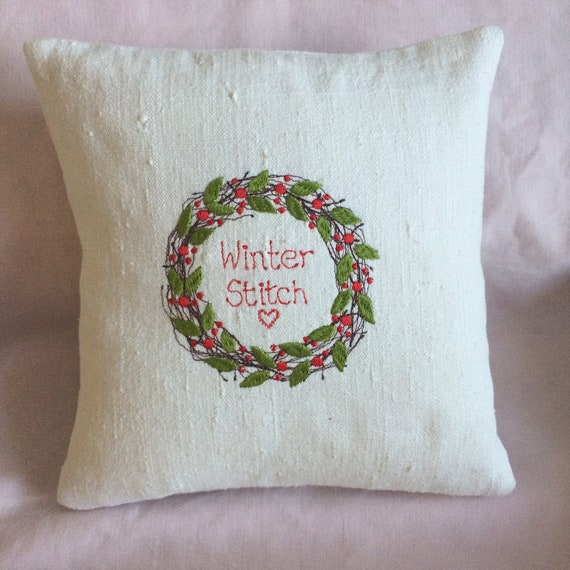 Christmas Wreath Cushion; rich, bright red embroidered berries + green leaves on white vintage linen, Scandi look