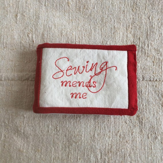 Needlecase in rich vintage reds with embroidered 'Sewing Mends Me'