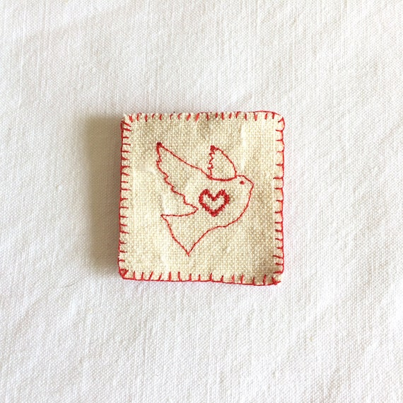 Vintage fabric and cross stitch embroidered lapel brooch for a sewer - Shaker style, heart and dove