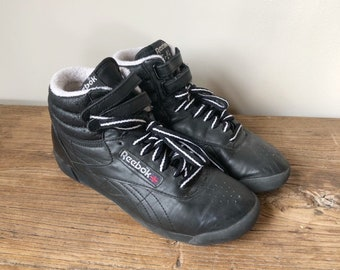 537efbb03fa733 Vintage 80s Women s Reebok Freestyle Hi Top Black Leather Sneakers