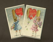 Pair of Vintage Valentines Tuck & Sons Valentine Posies – Girl at Heart Shaped Window