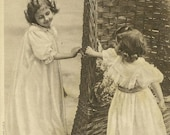 Two Sisters Playing by Wicker Chair Antique French Postcard 1907