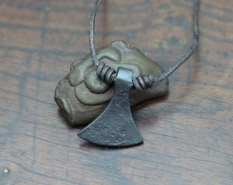 Viking Axe Head pendant.  Hand forged of pure iron. Miniature Axe shape based on the Dane axe. Adjustable necklace. With gift box.